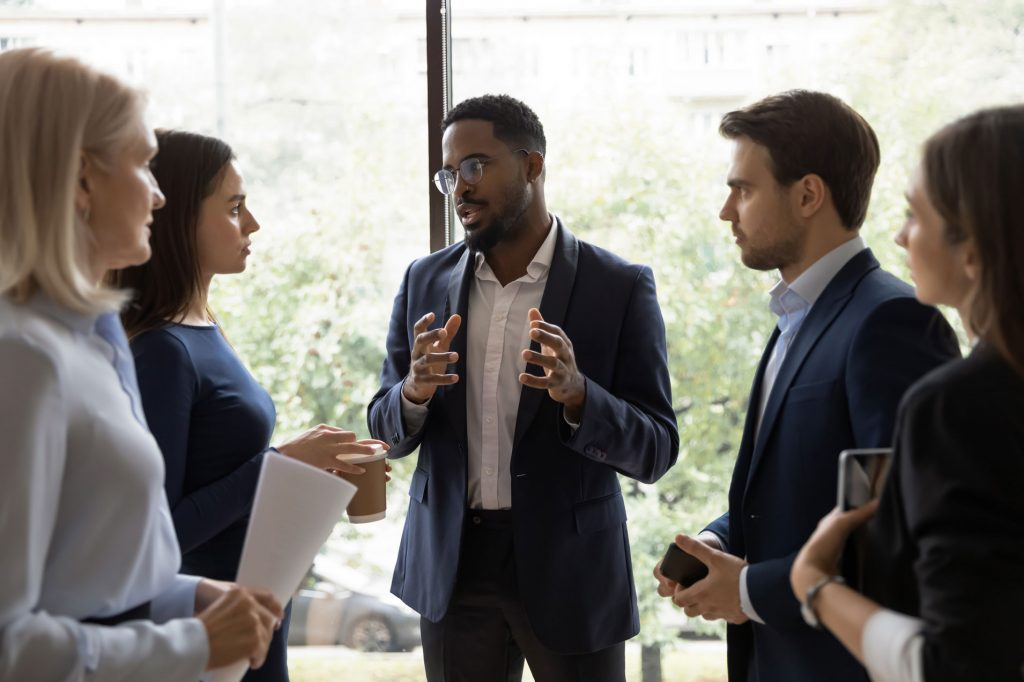 Confident business man presenting to group