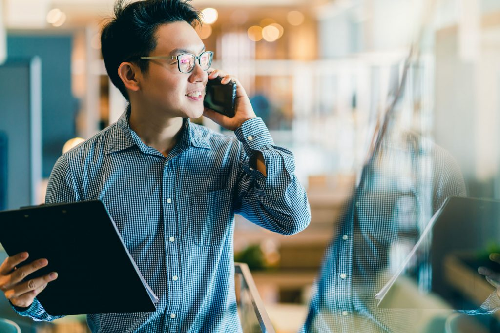 Confident business man on phone call